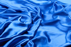 Shiny blue silk fabric Royalty Free Stock Images