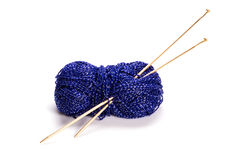 Shiny blue wool and needles. Shiny blue wool and yellow needles  on white background Stock Images
