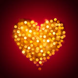 Shiny blurred gold heart Royalty Free Stock Images
