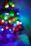 Shiny blurred lights jn the Christmas fir Royalty Free Stock Photos