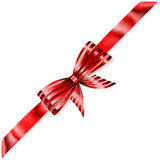 Shiny bow with diagonally ribbon. Beautiful striped red shiny bow with diagonally ribbon with shadow Royalty Free Stock Image