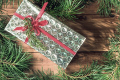 Shiny box with a gift under the tree Stock Image