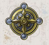 Shiny Compass. A shiny brass compass on a textured old map background Stock Photo
