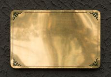 Shiny brass metal sign texture. Shiny brass yellow metal sign plate texture isolated with clipping path Stock Photography