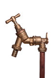 Shiny brass outside tap on white. Vertical stand pipe with brass tap royalty free stock photography