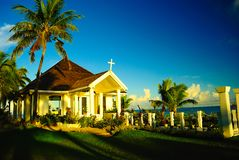 Shiny and bright church on the beach with coconut palm trees on pacific island royalty free stock image