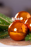 Shiny bright copper colored Christmas balls Royalty Free Stock Photos