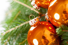 Shiny bright copper colored Christmas balls Royalty Free Stock Image