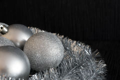 Shiny and bright silver christmas balls decoration lying on silv Royalty Free Stock Image