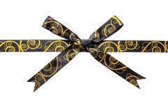 Shiny brown and gold satin ribbon Royalty Free Stock Photography