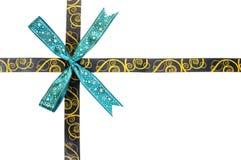 Shiny brown and gold satin ribbon Stock Image