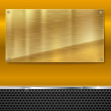 Shiny brushed metal gold, yellow plate with screws. Stock Images