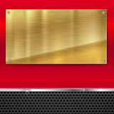 Shiny brushed metal gold, yellow plate with screws. Stock Image