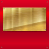 Shiny brushed metal gold, yellow plate with screws. Stock Photography