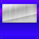 Shiny brushed metal plate with screws. Stock Image
