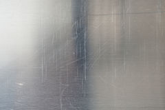 Brushed metal texture. A shiny brushed silver metal texture for your backgrounds Royalty Free Stock Image