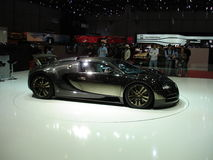 Shiny Bugatti. A shiny carbon fiber Bugatti Veyron exposed at the 2009 geneva autoexpo at the Mansory stand Stock Photos