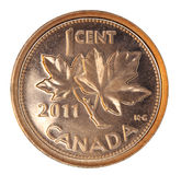 Shiny Canadian One Cent Coin. Smallest coin, depicting the national symbol, the maple leaf.  (The Canadian mint maintains copyright on the design, so only Stock Photos