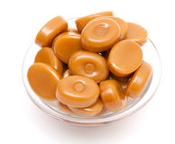 Shiny caramel candies in a glass bowl Stock Images