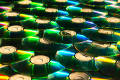 Shiny cd discs lie on each other and shine Royalty Free Stock Images