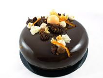 Shiny chocolate cake with oranges, chocolate ganache and whipped white chocolate cream royalty free stock photo
