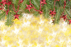 Shiny Christmas background with ornaments and fir tree Royalty Free Stock Images