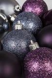 Shiny christmas balls. Silver and purple shiny and mat christmas balls stock photos