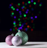 Shiny christmas balls on the black background with colorful boke. H Royalty Free Stock Photo