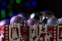 Shiny christmas balls on the black background with colorful boke. H Royalty Free Stock Image