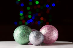 Shiny christmas balls on the black background. With colorful bokeh Royalty Free Stock Photography
