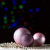 Shiny christmas balls on the black background. With colorful bokeh Stock Photography