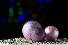 Shiny christmas balls on the black background. With colorful bokeh Royalty Free Stock Image