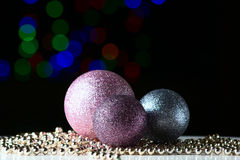 Shiny christmas balls on the black background. With colorful bokeh Royalty Free Stock Photo