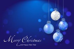 Shiny christmas balls on blue background - place for your text Royalty Free Stock Photos