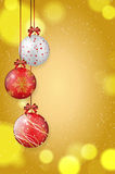 Shiny christmas balls on golden background - place for text Stock Photography