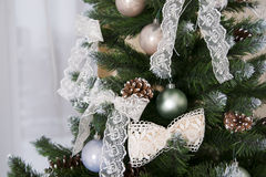 Shiny Christmas balls hanging on pine branches Royalty Free Stock Images