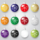 Shiny christmas decoration with snowflake color small baubles Royalty Free Stock Photo