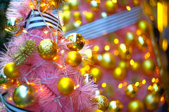 Shiny christmas decorationson top of a tree Royalty Free Stock Image