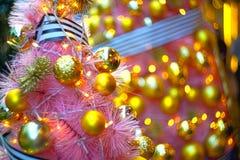 Shiny christmas decorationson top of a tree Royalty Free Stock Image