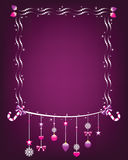 Shiny christmas frame with hanging ornaments. Stock Photos