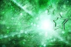 Shiny christmas ray lights with star symbols Royalty Free Stock Images