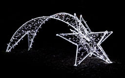 Shiny christmas street decoration in the shape of a comet made o Royalty Free Stock Image