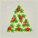 Shiny Christmas Tree Composed from Green Leaves. Royalty Free Stock Photo