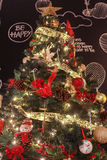 Shiny Christmas Tree Full of Decoration in Front of the Black Wa. Ll Stock Photos
