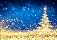 Shiny Christmas Tree - Golden Dust Glittering. In The Blue Background Stock Photography