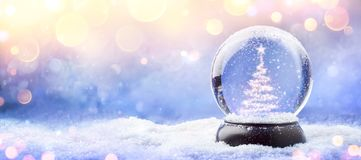 Free Shiny Christmas Tree In Snow Globe On Snow Royalty Free Stock Images - 163173069