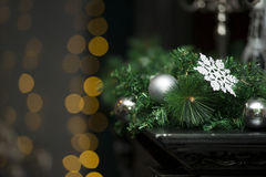Shiny Christmas white ball hanging on pine branches with festive background close-up Royalty Free Stock Images
