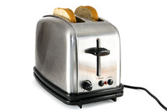 Shiny chrome toaster with two slices of bread Royalty Free Stock Photo
