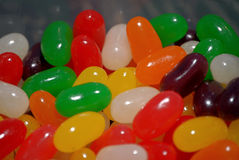Shiny Close up vision of  tasty sweet jellybeans in a travel container Royalty Free Stock Image
