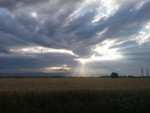 Shiny clouds. Sunny day somewhere in Romania Stock Photos